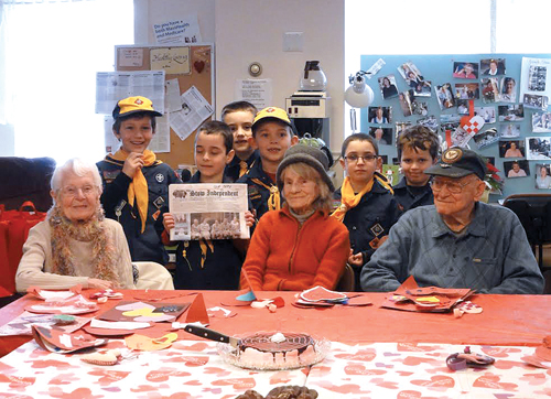 In support of a cub scout project, students of the Center School Second Grade voluntarily created valentines for Stow Seniors. Stow Cub Scout Pack 39, Wolf Den 7, shown in the enclosed photo with a few of the event attendees and The Stow Independent, delivered them during the Council on Aging's Chocolate Buffet/ Valentine Party on Friday, Feb 14th.
