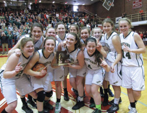 The Nashoba girls basketball team celebrates with the Central Mass D2 trophy. The Chieftains defeated the Medfield Warriors 57-55 in overtime to earn back-to-back Central Mass Division 2 championship titles.  More on the story below.  (Ellen Oliver )