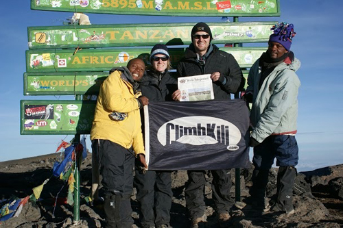 After a 6 day hike, Frank Smith (of Stow), his girlfriend Suz Gill, and guides Evance and Seraphin reached the summit of Mount Kilimanjaro at sunrise.