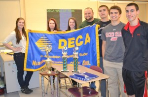 Members of NRHS DECA pose with a few of its prize hardware from past competitions. Left to right are Joyce LaBonte, Jackie Kalinowski, Michaela Colarossi, adviser Stravros Andreopoulis, Mike Curtin, Matt Curtin, and Mark Puleo.                                                                               (Ann Needle)