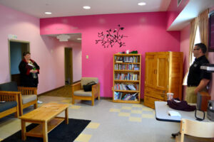 Valerie Paen and David Tivnan  in the bright pink lounge of the girls' wing of the RFK residential building.                                                                                                                                       Ann Needle