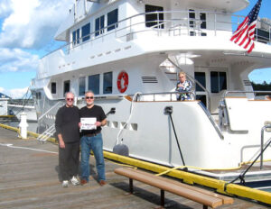 Ross Perry and Craig  Mundie arrive in Friday Harbor, WA after a 7 day, 1200 mile trip from Dana Point, CA. In March, they brought the 86ft Nordhaven from San Cabos Mexico to Dana Point CA. Pictured with Ross are Craig and Marie Mundie, formerly of Stow.