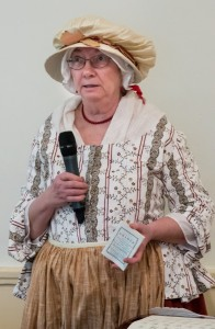 The Stow Minutemen's Linda Stokes uses a more modern tool for explaining the night's agenda.                                                              ( Courtesy Dwight Sipler )