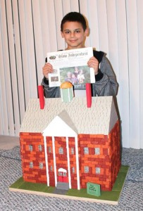 Nicolas Valentino, son of the Independent's bookkeeper Michelle Valentino, shows his  fifth grade project. The assignment was to build a structure. Nicolas decided to build the Upton Building in Westminster, that was used as a school from 1912- 1997.
