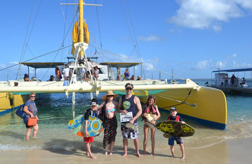The O'Riorden family traveled to St. Martin and took a gastronomic snorkeling tour, which included a pig roast, to the Prickly Pear Cays aboard the Winner Touch catamaran.  All had a spectacular time!  Pictured from left to right is Tristan, Theresa, Stephen, Rosemarie, and Sawyer.