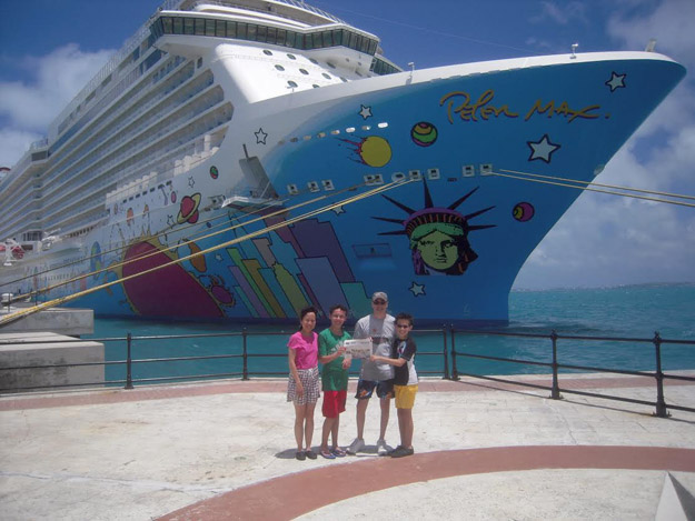 "In July, Liz, John, Michael & Matthew Urbano enjoyed an extended family reunion cruise to Bermuda for 7-nights aboard the Norwegian Breakaway.  This new ship had lots of fun activities including a ropes course, rock climbing wall, five full-size water slides including twin ""free fall"" slides, and miniature golf.  While in Bermuda, we went swimming and snorkeling at Warwick Long Bay Beach and Horseshoe Bay Beach, both located in the South Shore Park.  Pictured (l-r): Liz, Michael, John, and Matthew Urbano in front of the Norwegian Breakaway docked in Bermuda at Kings Wharf, Royal Naval Dockyard."