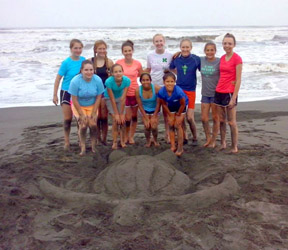 Katherine Hamilton (far right, standing) on the beach in Panama where the group of Scouts pitched in to help endangered sea turtles.  Courtesy photo