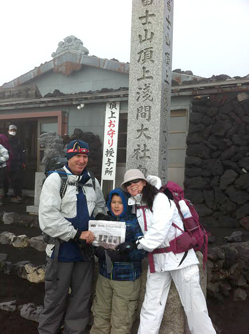 Last year the Stow Independent made it to the 5th Station of Mt Fuji (only 1/2 way up).  This year it finally made it to the very top to see an amazing sunrise over Japan (land of the rising sun).  Pictured with the Stow Independent are Andy, Jason, and Kumi Ladd on July 17 at the shrine on the summit.
