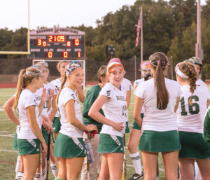 Off to a great start, the Nashoba Field Hockey team on the sidelines of the home opening game against Groton-Dunstable on Monday. Showing a score of 3-0 at the time, the team went on to win 8-1.            Adrian Flatgard; frequentflyerphotographer@gmail.com