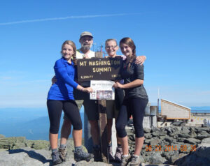 "Gwen Landis and Gordon Landis of Stow, Carole Seidenpfennig of Acton, and Emmeline Weeks of Maynard on the top of Mount Washington, the ""high point"" in our 4 day ridge-line traverse of the Presidential Range in the White Mountains."