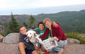 "The Farris family took a camping trip to Acadia National Park in Maine.   Pictured  on the top of Cadillac Mountain are Anne, Kenny and Amy Farris, with their dog Stanley.  Amy wrote, ""Soon after the photo was taken we watched a beautiful sunset. We had a great trip. The kids had a great time clamboring over the rocks.  Stanley enjoyed going everywhere with us, including on the shuttle bus and in the stores in Bar Harbor."""