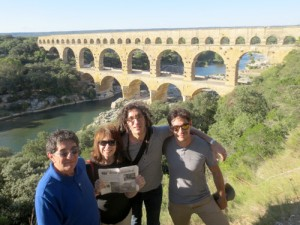 In August, the Thall family – Rich, June, Aaron, Jason – visited Pont du Gard, the best extant example of Roman aqueduct bridges.      It was constructed 2000 years ago as part of a 50 km aqueduct carrying water from a spring in Uzes to the Roman city of Nimes in what is now southern France, near Marseille.  The three tiers of arches carried the aqueduct over the Gardon River 48 m (160 ft) below and spanned 275 m (902 ft) at the top.  The Nimes Aqueduct is estimated to have supplied 200,000 m3 (44 million gallons) of water per day.      The family was vacationing with son, Aaron, who lives in Geneva.