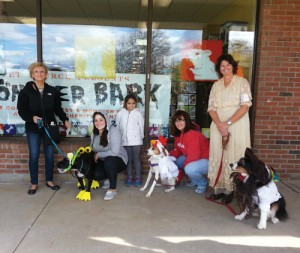 "The seventh Annual Monster Bark was held at Pet Source in Stow on Sunday. The costume contest and parade raises money for charity. Pictured above, left to right, are contenst winners Ivory ""Scuba Dog"", first place; Ally ""The Chicken,"" third place; and ""Moon Sparrow,"" second place.   More on the story above.                                                                                                                                     Ann Needle"