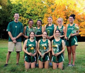 Coach Dan Glover with the senior girls on the Chieftain's Cross Country team.                                                                                                                     Susan Shaye; www.susanshaye.com