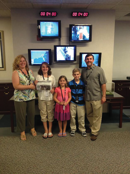 The Smith Family (Jill, Jacki, Tessa, Spencer, and Gary) at the United Launch Alliance flight center at Cape Canaveral, FL. The rocket on the monitors was launching a satellite that Gary worked on.