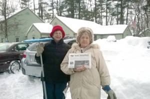 "Diane Bachtell (left) and Violet Gray stop to pose for a photo while cleaning up the snow in the Plantation Apartments parking lot after a blizzard dumped 32"" of snow."