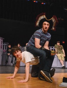 Captain Hook (Sam Keith) takes a seat on Smee (Tyler Plaskon).                                                                                                 Jonathan Daisy; DaisyDesignPhotography.com