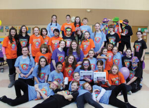 The cast of Hale Middle School Drama's Godspell, pose with The Stow Independent