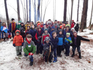 Stow Cub Scout Pack 39 and members of their families hiked through the Stow Town Forest on Saturday March 28 to the shore of the Assabet River where they had breakfast, juice, and hot chocolate on a brisk and snowy spring morning.