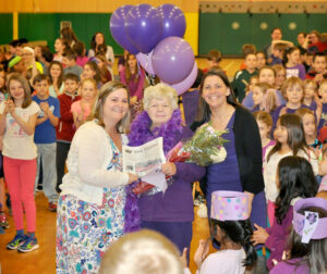 Gladys McClellan with teachers Maura Sheehan (left) and Lisa Wallat (right) at a recent student-driven All School Assembly at Center School honoring Gladys for her many hours of volunteer work at the school.
