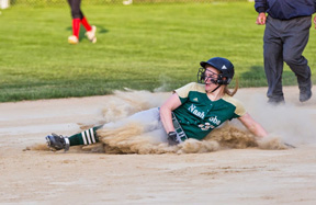Senior Erin Cressman slides into the plate                                                               Susan Shaye