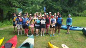 Some of the 50 members and friends of the First Parish Church of Stow and Acton who went for a canoe/kayak trip down the Contoocook River in Concord, NH in July paused to pose with the Stow Independent before embarking.