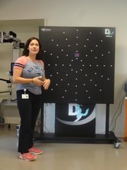 Occupational therapist Kristen Dixon Kielty demonstrates the Dynavision system, which helps patients recovering from concussion improve their ability to respond to signals in their peripheral vision.            Jordana Bieze Foster