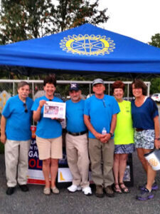 On August 27, the Rotary Club of Nashoba Valley held its final Wings & Wheels event of the season and celebrated with a copy of The Stow Independent! The weather held up for the  summer, and local Rotary clubs raised several thousands of dollars through donations, food sales, and sponsors for local and international community service projects. Check out photos from the entire season at www.facebook.com/WingsandWheelsMA and www.WingsandWheelsMA.com