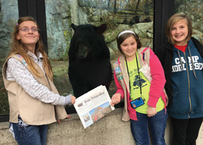 Alex Soeltz, Caroline Kotosky and Elise Albrittain of Stow Girl Scout Troop 72516 at the Buttonwood Zoo in New Bedford, MA.