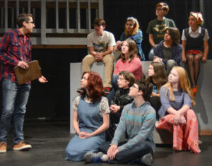 Cam Walbridge (standing, Mr. Farrell) leads an acting class with (bottom to top, L to R): Emily Adams, Colby Storey, Will Moalli, Olivia Bradley, Allie Spratt, Gwen Burke, Austin Gauthier, Camden Storey, Sarah Newton, Sophia Lauer, and Emma Yvanovich.                                                                           Courtesy