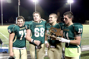 Pictured (l-r) with the Div. 2 Trophy: Will Phaneuf, Bobby Denaro, Mike Curtin, Egan Bachtell. The team will play at Gillette Stadium in the State Finals Saturday, Dec. 5.                                                                     							           Courtesy Eric Bachtell