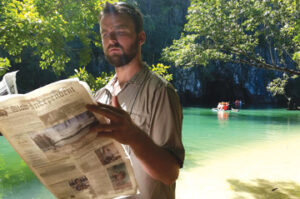 Prior to his expedition into the Underground River at Puerto Princesa Subterranean River National Park on the island of Palawan in the Philippines, Frank Smith checks the local news.