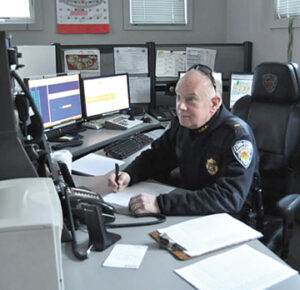 Lt. Rusty Marino at the dispatch desk                                                       Nancy Arsenault