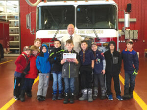 On Dec. 28, the Stow Cub Scouts WEBELOS Dens 5 & 7 visited the Mass. Firefighting Academy off State Road.  They had a personal tour of the facility from Deputy Director Joseph J. Klucznik, center, and watched the student firefighters running drills in the Burn Building out back.