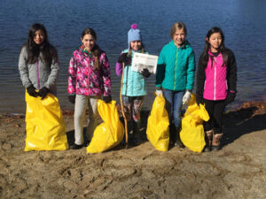 Girl Scout Troop #75253 spent time picking up trash at the Pine Bluffs recreation area during the town-wide clean up.  This was a great way for the girls to help their community and to continue to strive towards their Bronze Award.  The girls are trying to get the word out about protecting marine wildlife through keeping trash and recyclable materials out of lakes and oceans.