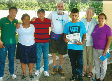 Pat and Bob Walrath took the Stow Independent to El Salvador to visit Bob's sponsored boy, Josue, and former sponsored boy, Pedro.  Bob sponsors Josue through Unbound (formerly the Christian Foundation for Children and Aging) of Kansas City, KS.  Here they are at Unbound's El Salvador headquarters in Santa Ana with Josue holding the Stow Independent.  From the Left are Pedro's younger brother Marco, Pedro's mother Hannah, Pedro (now a chef), Bob, Josue, Pat, and Josue's grandmother Maria.