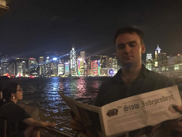 Frank Smith checks up on local events while attending the Symphony of Lights show over Victoria Harbour in Hong Kong. The nightly show involves more than 40 buildings on both sides of the harbor, with music and narration playing simultaneously.